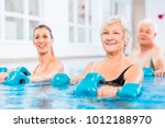 people young and senior in... | Shutterstock . vector #1012188970