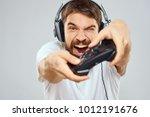 joyful man with headphones... | Shutterstock . vector #1012191676