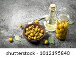 pickled olives with olive oil.... | Shutterstock . vector #1012195840