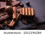 broken chokolate bars and... | Shutterstock . vector #1012196284