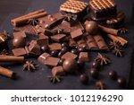 broken chokolate bars and... | Shutterstock . vector #1012196290