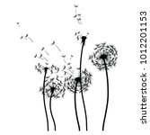 silhouette of a dandelion with... | Shutterstock .eps vector #1012201153