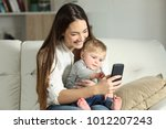 mother and baby playing with a... | Shutterstock . vector #1012207243