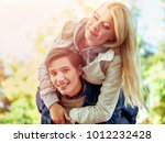 couple hugging and flirting in... | Shutterstock . vector #1012232428