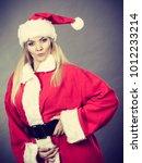 Small photo of Xmas, seasonal clothing, winter christmas concept. Confident woman wearing Santa Claus helper costume