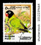 Small photo of MOSCOW, RUSSIA - DECEMBER 21, 2017: A stamp printed in Afghanistan shows Masked Lovebird (Agapornis personatus), Parrots serie, circa 1999