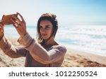 hipster young girl photograph... | Shutterstock . vector #1012250524