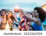 happy friends taking selfie... | Shutterstock . vector #1012261924