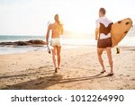 surfer friends running with... | Shutterstock . vector #1012264990
