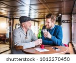 senior father and his young son ... | Shutterstock . vector #1012270450