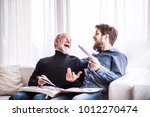hipster son and his senior... | Shutterstock . vector #1012270474