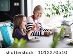 a small girl with grandmother... | Shutterstock . vector #1012270510