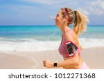 fitness woman run on the beach | Shutterstock . vector #1012271368