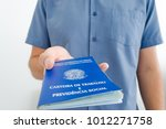 a worker with a new job show...   Shutterstock . vector #1012271758