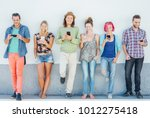 young people watching on their... | Shutterstock . vector #1012275418