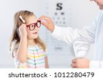 child at eye sight test. little ... | Shutterstock . vector #1012280479