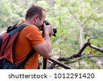 professional male photographer... | Shutterstock . vector #1012291420