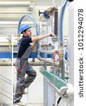 assembler in an industrial...   Shutterstock . vector #1012294078