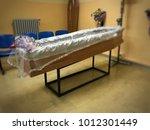 deceased in mortuary room | Shutterstock . vector #1012301449
