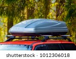 car with roof luggage box... | Shutterstock . vector #1012306018