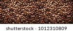 roasted coffee beans background.... | Shutterstock . vector #1012310809