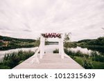 beautiful wedding arch on the... | Shutterstock . vector #1012315639