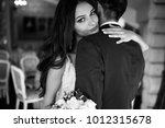 the bride is looking from... | Shutterstock . vector #1012315678