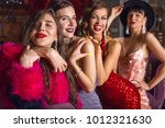 group of young laughing stylish ... | Shutterstock . vector #1012321630