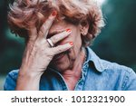 older women worrying with her... | Shutterstock . vector #1012321900