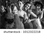 group of young laughing stylish ... | Shutterstock . vector #1012322218