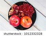 red juice pomegranate on black... | Shutterstock . vector #1012332328