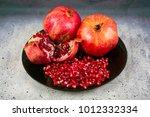 red juice pomegranate on black... | Shutterstock . vector #1012332334