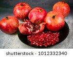 red juice pomegranate on black... | Shutterstock . vector #1012332340