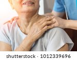 elderly female hand holding... | Shutterstock . vector #1012339696