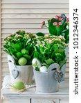 Small photo of Kalanchoe blossfeldiana decorations. Simple home arrangements with springtime flowers.