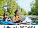 family kayaking sport  mother... | Shutterstock . vector #1012362004