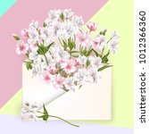isolated envelope with flowers  ... | Shutterstock .eps vector #1012366360