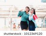 beautiful girls and friend in... | Shutterstock . vector #1012369120