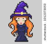 sweet witch in a purple hat ...   Shutterstock .eps vector #1012373053