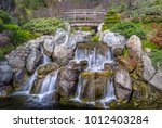 waterfall and bridge with silky ... | Shutterstock . vector #1012403284