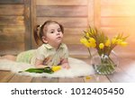 a small child with a bouquet of ... | Shutterstock . vector #1012405450