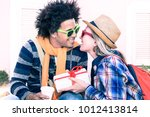 young interracial couple... | Shutterstock . vector #1012413814