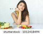 unhappy asian women is on... | Shutterstock . vector #1012418494