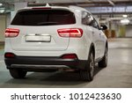 Stock photo new white sports car at underground parking rear side view 1012423630