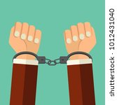 Stock vector vector illustration handcuffs on hands of criminal man arrested man in handcuffs flat style 1012431040