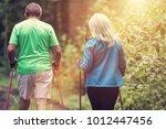 senior couple walking together...   Shutterstock . vector #1012447456