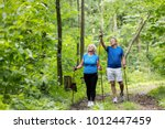 elderly man and woman admiring...   Shutterstock . vector #1012447459