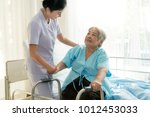 asian young nurse supporting...   Shutterstock . vector #1012453033