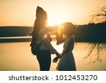 female tourists in beautiful... | Shutterstock . vector #1012453270