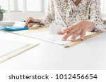 business woman holding a... | Shutterstock . vector #1012456654